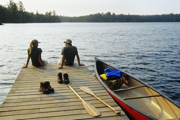 Teenagers on dock, Lyons Lakes, Whiteshell Provincial Park, Manitoba, Canada.