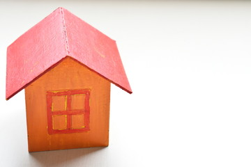 yellow model of house as symbol on white background