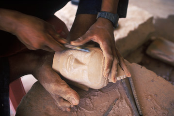 South East Asia, Cambodia, Siem Reap, artisan carves Buddha head for tourism trade