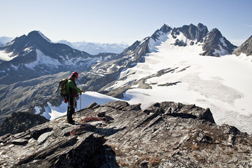 A young man alpine climbing the west ridge of Mt Tupper, Roger's Pass, Glacier National Park, BC
