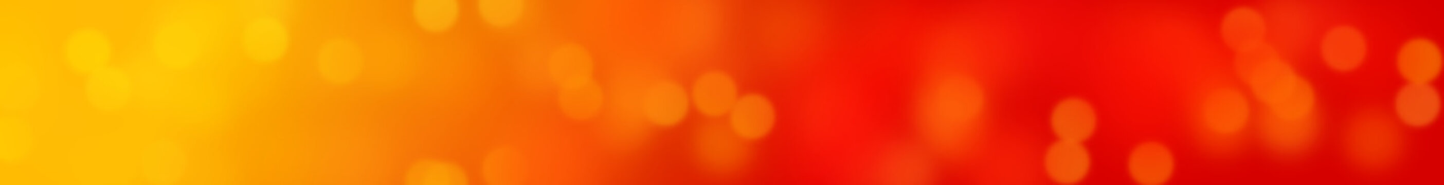 bokeh effect banner background in shades of soft yellow, red and orange