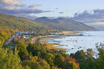 Village nestled between mountains and the St. Lawrence River, Petite-Riviere-Saint-Francois, Charlevoix, Quebec, Canada