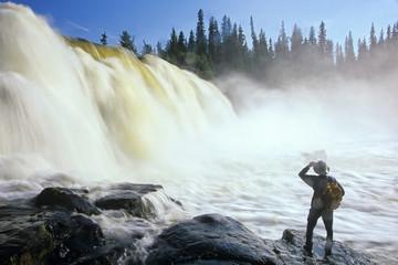 Hiker at Pisew Falls, Pisew Falls Provincial Park, Manitoba, Canada.