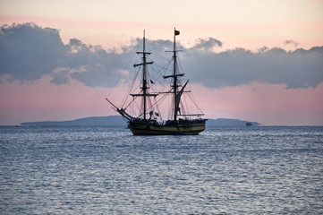 Türaufkleber Schiff sailing ship at anchor, a calm sea and cloudless sky