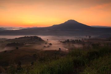 Misty morning sunrise in Khao Takhian Ngo View Point at Khao-kho