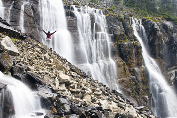 A female hiker at Seven Veils Falls near Lake Ohara in Yoho National Park, British Columbia, Canada.
