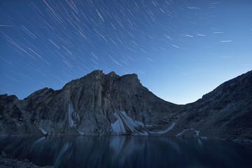 Star trails over Radalet Peak in the Yukon Coast Mountains, near Carcross, Yukon.