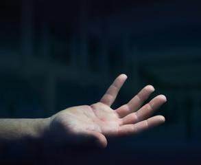 Businessman hand on black dark background