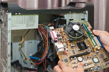 close-up on the hands of the technician repairing a compute