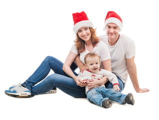 young couple with little boy and presents on the floor