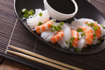 Dietary food: Shirataki with prawns, spring onions and soy sauce close-up. horizontal