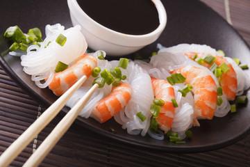 Shirataki Noodles with shrimp and green onions close-up. horizontal
