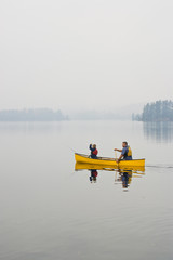 Young/middle-aged man going fishing with son on Source Lake, Algonquin Provincial Park, Ontario, Canada.