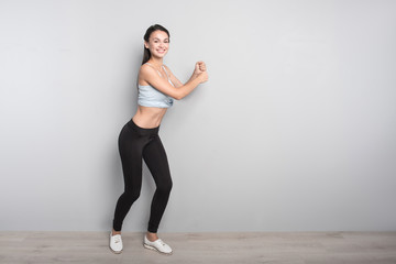 Cheerful woman doing sport exercises