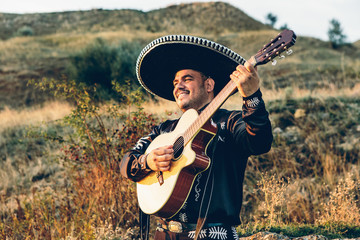 Mexican, Latin American, Spanish. Musician on the coast.