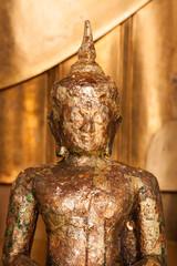 Golden buddha statue at Wat Pho, Bangkok Thailand.