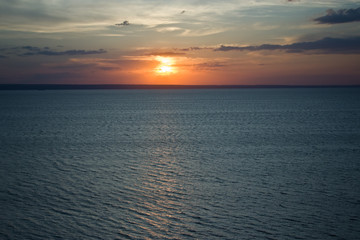 The setting sun in the Volga River