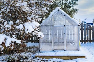 Backyard Greenhouse after a snowfall