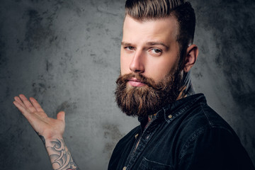 Bearded hipster male in a black shirt.