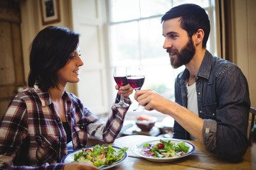 Couple toasting glasses of wine