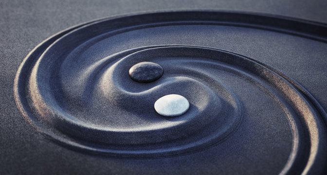 Yin Yang Motiv - Steine im dunklen Sand 2