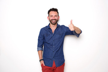 Confident mature man showing thumbs up
