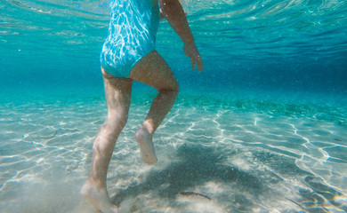 Girl walking in shallow waters