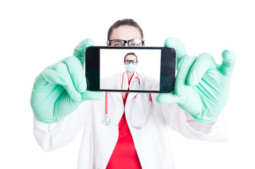 Woman doctor with googles and smartphone
