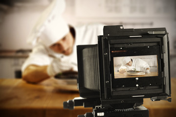 camera and cook in kitchen