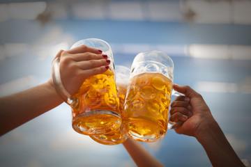 Raised beer mug toasting at Oktoberfest