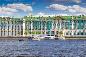 Royal Hermitage palace on the bank of Neva river in summer sunny day, Saint Petersburg, Russia.