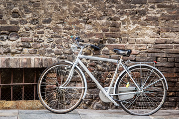 Classic bicycle standing on the street in Italy.
