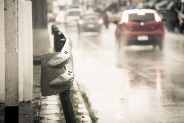 guardrail on roadside with rainy day