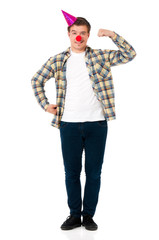 Handsome man clown isolated on white background. Teen boy with crazy look making faces and wearing red nose.