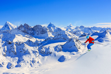 Skiing with amazing view of Swiss famous mountains.