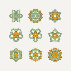 Set of ornate vector mandala symbols. Mehndi lace tattoo. Oriental weave with sharp corners.