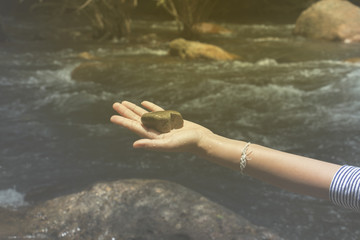 hand sign and  water,water is cold ,waterfall in natural