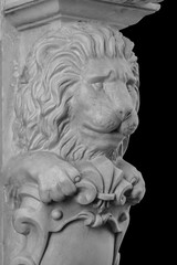 gypsum pommel carved pillars in the form of a lion's muzzle