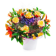 Colorful flower bouquet from roses and other flowewrs isolated on white background.