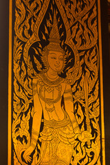 god in Thai style hand painting art golden color on window of the temple