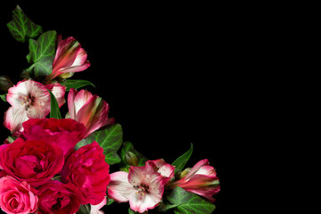 frame of roses and rhododendron flowers on a black background