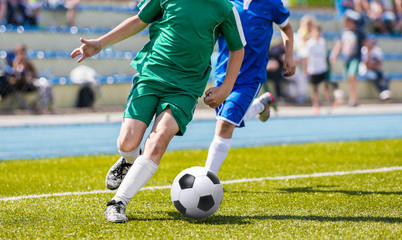 Soccer Players In Action. Football Players Running On The Field