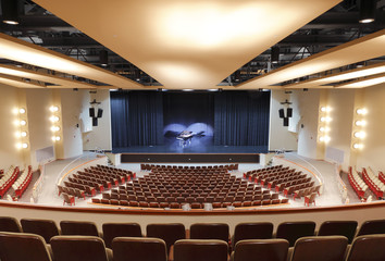 Grand piano on auditorium stage