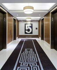 Lifts in corridor on fifth floor of hotel