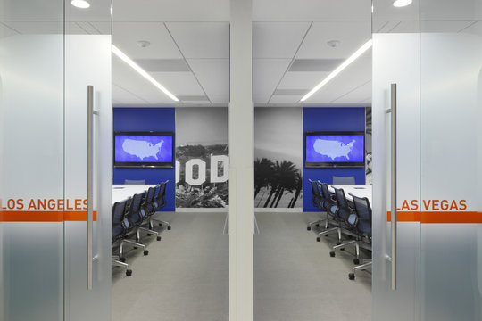 View through glass doors of office chairs and desks