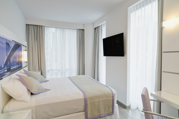 Double bed in modern hotel room
