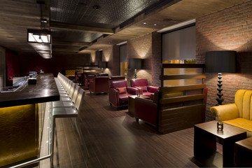Empty bar with modern leather chairs