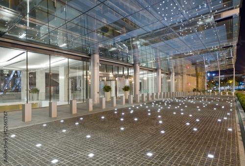 Lights On Tiled Floor Under Glass Canopy Modern Building
