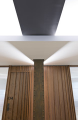 Wood paneled door and ceiling