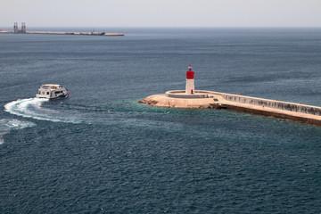 Beacon at exit from bay in sea. Cartagena, Spain